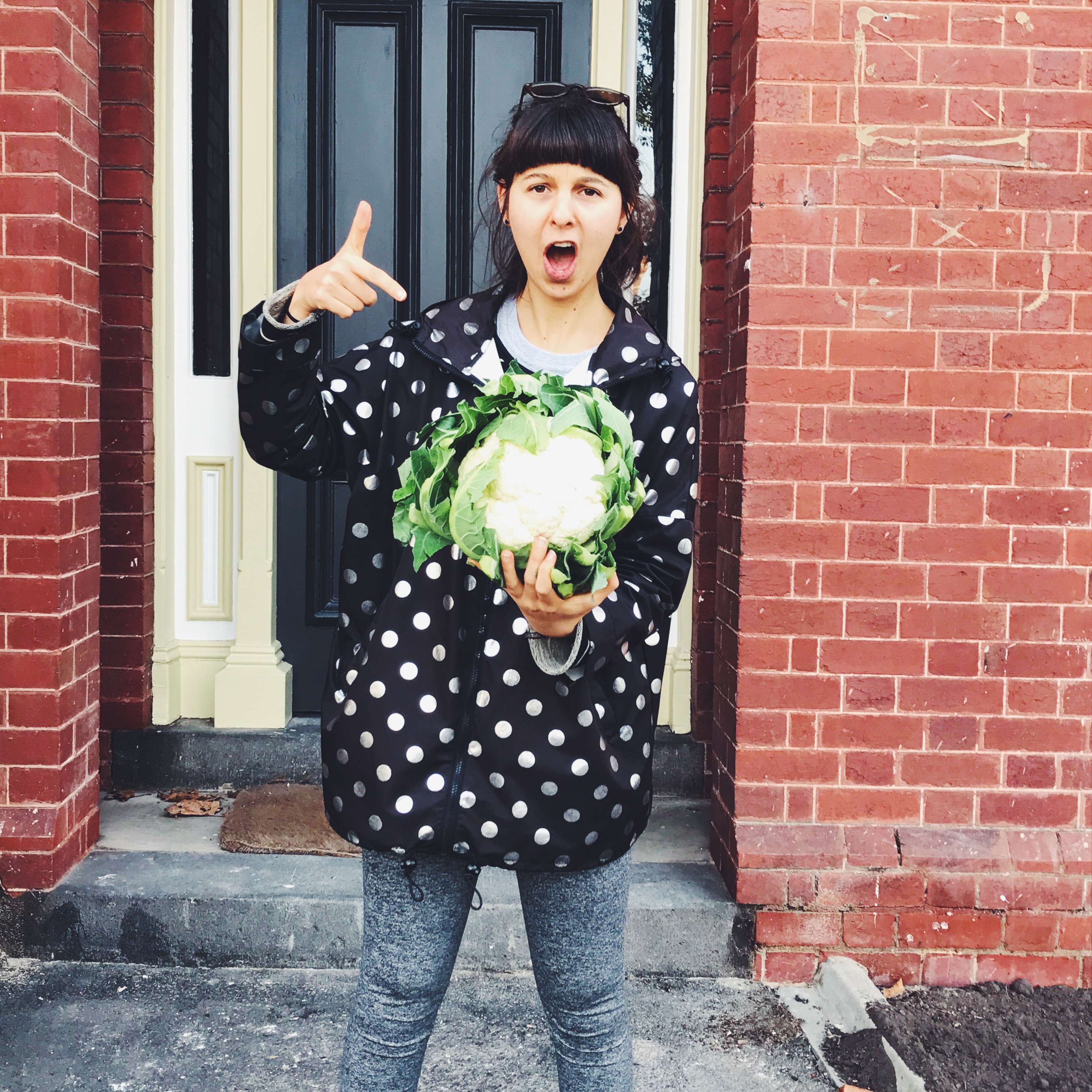 Picture of me holding cauliflower | Camilla Ferraro Nutritionist